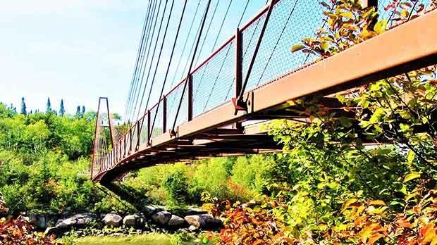 Suspension bridge crossing the Whiteshell River. Photo by Sharon Williams.
