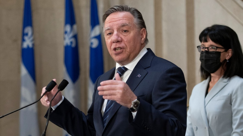 Quebec Premier Francois Legault reacts to the federal election, Tuesday, September 21, 2021 at the legislature in Quebec City. Quebec Minister Responsible for Canadian Relations and the Canadian Francophonie Sonia Lebel, right, looks on. THE CANADIAN PRESS/Jacques Boissinot