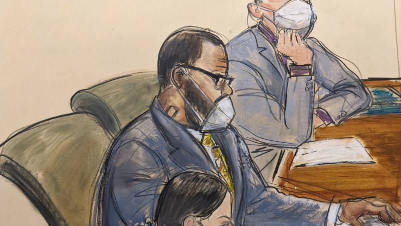 In this courtroom sketch, R. Kelly, centre, sits with his defense attorneys Thomas Farinella, top, and Nicole Blank Becker during the first day of his defence in his sex trafficking case, Monday, Sept. 20, 2021, in New York. (AP Photo/Elizabeth Williams)