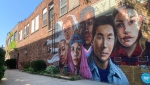 A new mural in Aylmer, Ont. painted by Megan Claire Kehoe with input from East Elgin Secondary School Students. (Brent Lale / CTV News)