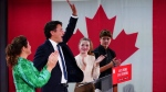 Prime Minister Justin Trudeau is joined on stage by wife Sophie Gregoire Trudeau, left, and children Xavier and Ella-Grace, during his victory speech at Party campaign headquarters in Montreal, early Tuesday, Sept. 21, 2021. THE CANADIAN PRESS/Sean Kilpatrick