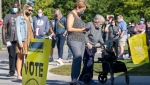 Voters line up at a polling station to vote in the Canadian federal election in Bowmanville, Ontario on Monday, September 20, 2021.THE CANADIAN PRESS/Frank Gunn