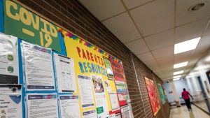 COVID-19 safety information is posted on the wall of a school in Toronto, Ont., on Wednesday, Aug., 26, 2020. THE CANADIAN PRESS/Christopher Katsarov
