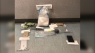 Police said a search of a vehicle on Thompson Drive and a search of a hotel room led to the seizure of cocaine, a large amount of Canadian currency, a kilogram of a white substance, and other drug-related paraphernalia. (Source: Manitoba RCMP)