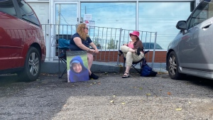 Stacy Kennedy (Left), chats with a supporter outside of Premier Doug Ford's constituency office. (Scott Lightfoot/CTV News Toronto)