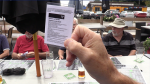 A man holds his COVID-19 vaccine receipt at a restaurant in Barrie, Ont., on Tues., Sept. 21, 2021 (Mike Arsalides/CTV News)