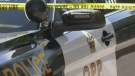 Police caution tape is seen in front of an OPP cruiser on Tues., Sept. 21, 2021 (Katelyn Wilson/CTV News)