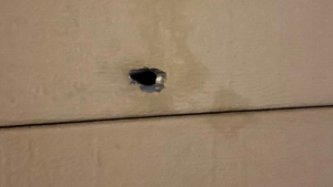A bullet hole was discovered in a garage door of a home on Thurman CIrcle in London, Ont., Sept. 18, 2021. (Source: London police)