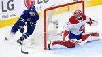 Montreal Canadiens goaltender Carey Price (31) covers the post as Toronto Maple Leafs left wing Zach Hyman (11) carries the puck from behind the net during first period NHL Stanley Cup playoff action in Toronto on Thursday, May 27, 2021. (THE CANADIAN PRESS/Frank Gunn )