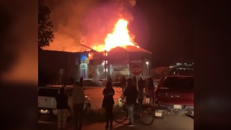 Videos posted to social media show flames shooting out of the roof of a condominium building at 1400 Pacific Avenue in Brandon on Sept. 21, 2021. (Source: Deveryn Ross/ Twitter)