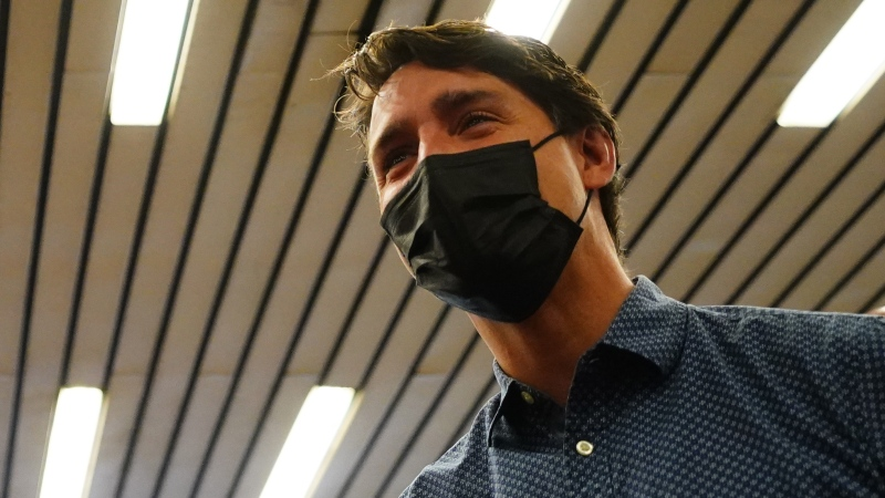 Prime Minister Justin Trudeau arrives to greet commuters at a Montreal Metro station on Tuesday, Sept. 21, 2021. THE CANADIAN PRESS/Sean Kilpatrick
