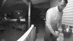 Footage captured by a doorbell camera appears to show newly elected Liberal MP George Chahal removing campaign literature from a doorstep in his riding of Calgary Skyview during the campaign. (Supplied)