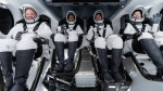 In this Sunday, Sept. 12, 2021 photo made available by SpaceX, from left, Chris Sembroski, Sian Proctor, Jared Isaacman and Hayley Arceneaux sit in the Dragon capsule at Cape Canaveral in Florida, during a dress rehearsal for the upcoming launch. (SpaceX via AP)