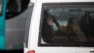 Migrants sit seen inside a Mexican Immigration vehicle in Ciudad Acuña, Mexico, Monday, Sept. 20, 2021. (AP Photo/Felix Marquez)