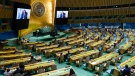 Somalia's President Mohamed Abdullahi Mohamed Farmajo is seen on video screens as he addresses the 76th Session of the United Nations General Assembly remotely, Tuesday, Sept. 21, 2021, at UN headquarters. (AP Photo/Mary Altaffer, Pool