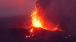 Lava from a volcano eruption flows on the island of La Palma in the Canaries, Spain, Tuesday, Sept. 21, 2021. (AP Photo/Emilio Morenatti)