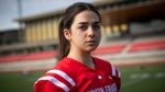 Simon Fraser University football team kicker Kristie Elliott, who recently became the first Canadian woman to play and score in a college football game, poses for a photograph before practice at the university in Burnaby, B.C., Tuesday, Sept. 21, 2021. (Darryl Dyck / THE CANADIAN PRESS)