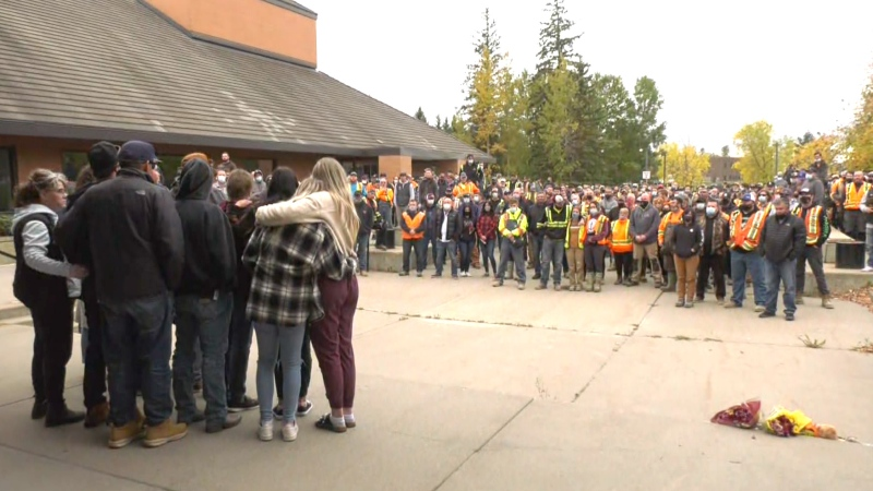 Hundreds of people attended court in Edson, Alta., on Sept. 21, 2021, on the day of Robert Major's first court appearance. Cody McConnell, partner of Mchale Busch, 24, and their son Noah, stands in front of the crowd. Busch and Noah were confirmed dead on Friday, Sept. 17, 2021.