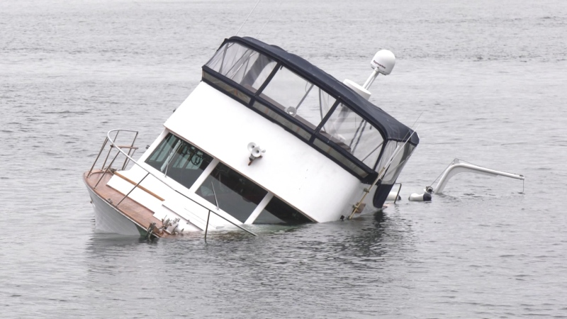 A boat was partially submerged near Vancouver's seawall on Sept. 20, 2021.