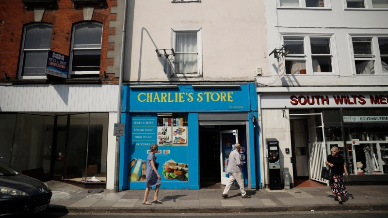 An exterior view shows Charlie's Store open as usual, in which CCTV from inside appeared to show Dawn Sturgess the day before she became seriously ill, in Salisbury, England, Friday, July 6, 2018. (AP Photo/Matt Dunham)