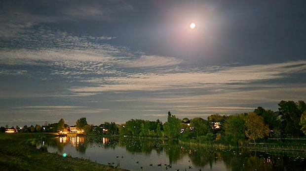 Moon over the pond in River Park South. Photo by Greg Carman.