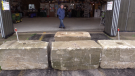 Concrete blocks placed in front of Phil Englishman's hangar at the Saugeen Municipal Airport, Sept. 22, 2021. (Scott Miller / CTV News)