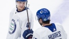 Vancouver Canucks' Elias Pettersson (40), of Sweden, talks with Quinn Hughes (43) during the NHL hockey team's training camp in Vancouver, on Wednesday, July 22, 2020. (Darryl Dyck / THE CANADIAN PRESS)