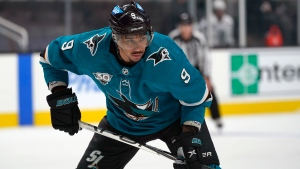 In this Wednesday, March 24, 2021 file photo, San Jose Sharks left wing Evander Kane (9) watches during an NHL hockey game against the Los Angeles Kings in San Jose, Calif. (AP Photo/Jeff Chiu, File)