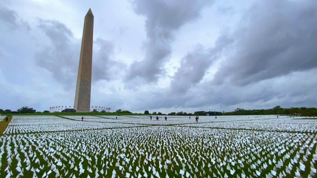 Each white flag planted beneath the Washington Monument represents an American life lost due to COVID-19. (CTV National News)