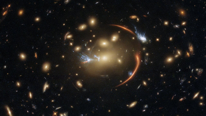 The slumbering, giant galaxy at the centre of this image is 10 billion light-years away. (Courtesy of ESA/Hubble & NASA, A. Newman, M. Akhshik, K. Whitaker)