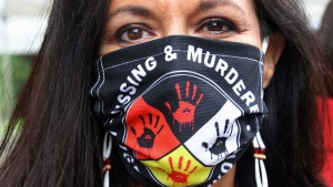 In this file photo, Jeannie Hovland, the deputy assistant secretary for Native American Affairs for the U.S. Department of Health and Human Services, poses with a Missing and Murdered Indigenous Women mask, in Anchorage, Alaska. (AP Photo/Mark Thiessen, File)