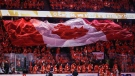 A large Canadian flag is passed over the Calgary Flames at the Saddledome before the start of Colorado Avalanche vs the Calgary Flames NHL playoff action in Calgary, April 13, 2019.(THE CANADIAN PRESS/Jeff McIntosh)