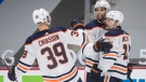 Edmonton Oilers' Alex Chiasson, from left to right, Darnell Nurse and Josh Archibald celebrate Nurse's goal against the Vancouver Canucks during the third period of an NHL hockey game in Vancouver, on Tuesday, May 4, 2021. THE CANADIAN PRESS/Darryl Dyck