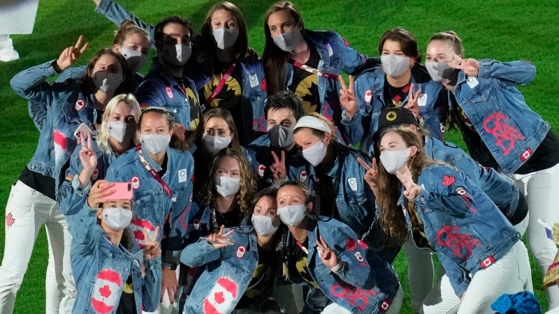 Canadian athletes pose for a photo during the closing ceremony in the Olympic Stadium at the 2020 Summer Olympics, Sunday, Aug. 8, 2021, in Tokyo, Japan. (AP Photo/Lee Jin-man)