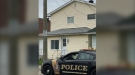 Timmins police car in front of house on Father Costello Drive