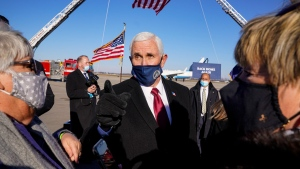 Former U.S. Vice President Mike Pence greets supporters in Columbus, Ind., on Jan. 20, 2021. (Michael Conroy / AP)
