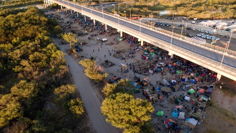 Migrants, many from Haiti, are seen in an encampment along the Del Rio International Bridge near the Rio Grande, on Sept. 23, 2021. (Julio Cortez / AP)