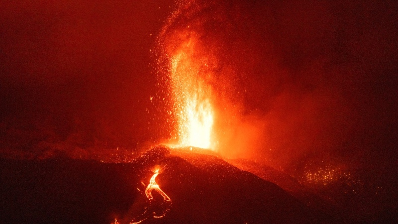 Lava from a volcano eruption flows on the island of La Palma in the Canaries, Spain, on Sept. 21, 2021. (Emilio Morenatti / AP)