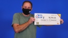 Giuseppe Guido, of Newmarket, hold his big cheque after winning a Lotto 6/49 second prize in the Aug. 7, 2021 draw. (OLG)