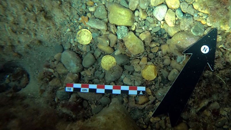 Eight coins were initially found by amateur freedivers. (University of Alicante / CNN)