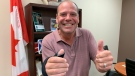 Chris Lewis gives two thumbs up at his constituency office in Essex, Ont. on Thursday, Sept. 23, 2021, after being re-elected in the riding. (Rich Garton/CTV Windsor)