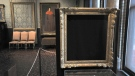 """In this March 11, 2010 file photo, empty frames from which thieves took """"Storm on the Sea of Galilee,"""" left background, by Rembrandt and """"The Concert,"""" right foreground, by Vermeer, remain on display at the Isabella Stewart Gardner Museum in Boston. (AP Photo/Josh Reynolds, File)"""