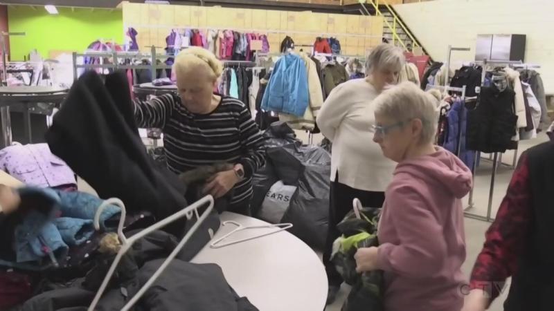 Volunteers sort clothing in CTV Coats for Kids in Sault Ste. Marie (pre-COVID-19)