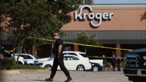 Police respond to the scene of a shooting at a Kroger's grocery store in Collierville, Tenn., on Thursday, Sept. 23, 2021. (Joe Rondone/The Tennessean via AP)