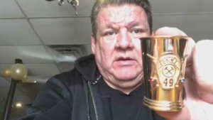 Gerard Lamontagne holds the 'Golden 49er' a solid gold shot glass made with gold mined in his community of Snow Lake, Manitoba. (Source: Gerard Lamontagne)