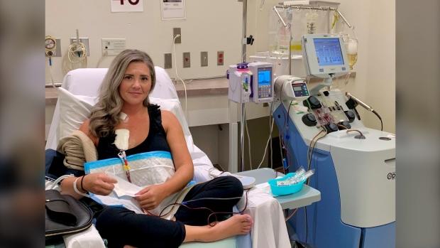 Krystal Graham receives a plasma treatment while she waits for a second liver transplant. (Supplied: Krystal Graham)