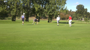 """Golfers """"putt-out"""" on 18th hole at Saanich's Cedar Hill Golf Course on Sept. 23, 2021. (CTV News)"""