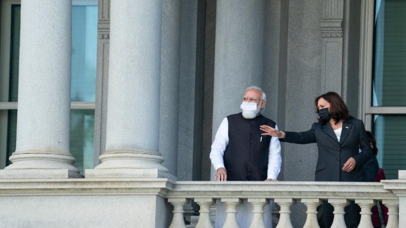 U.S. Vice President Kamala Harris talks with Indian Prime Minister Narendra Modi on the balcony of the Eisenhower Executive Office Building in Washington, on Sept. 23, 2021. (Evan Vucci / AP)