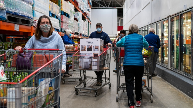 Shoppers wearing masks search for items at a Costco Wholesale store on February 26 in Colchester, Vt. (Robert Nickelsberg/Getty Images)
