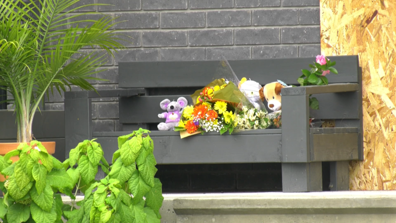 Flowers and stuffed animals left outside the home in Aylmer, QC where a father killed his two young daughters, then took his own life on Wednesday, Sept. 22, 2021.